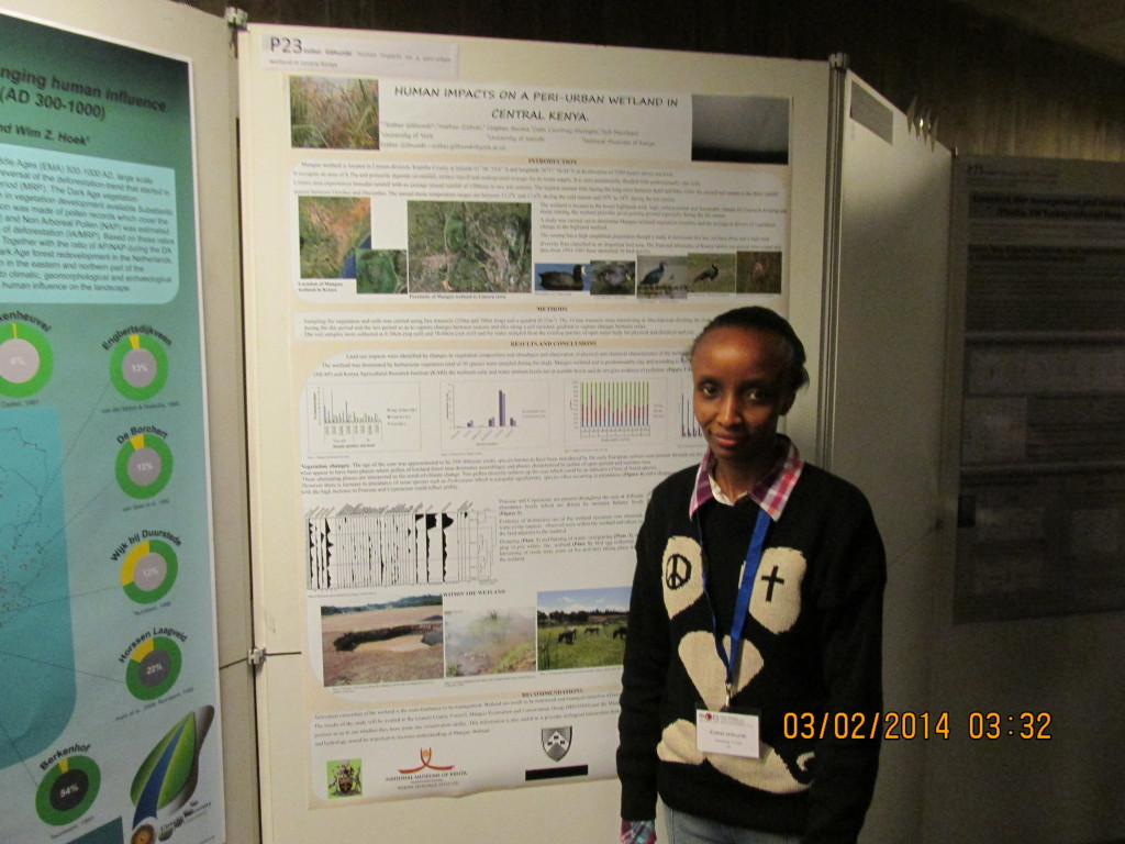 Esther next to her poster on Human imapcts on a peri-urban wetland in Central Kenya.