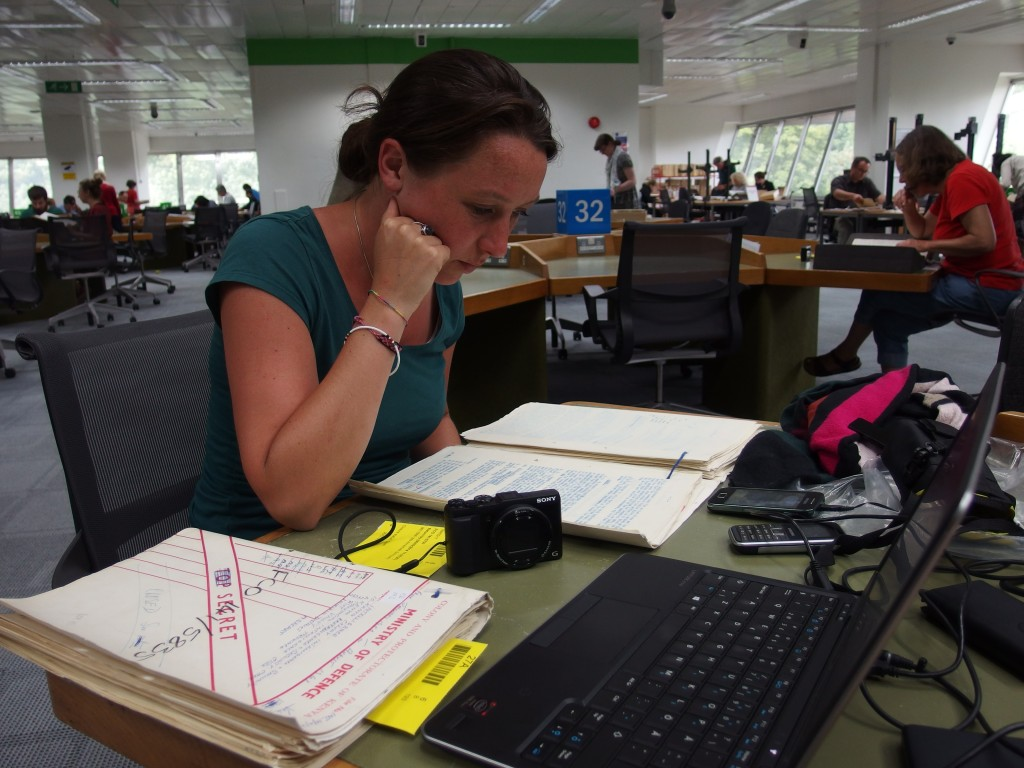 Annemiek reading files in the National Archives