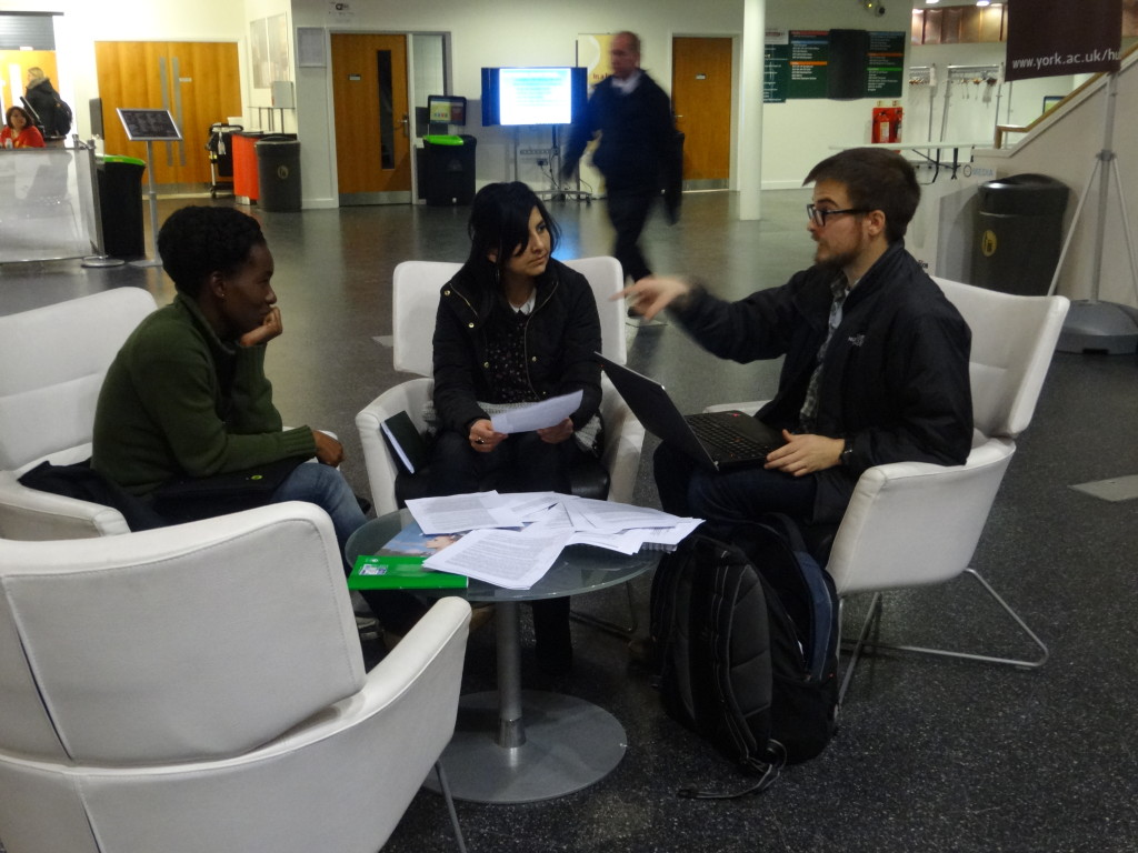 Christin Adongo participating in a group exercise with other phd students.o