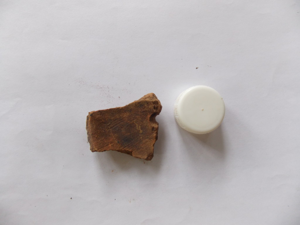 A drilled piece of pottery from Sokotei 1
