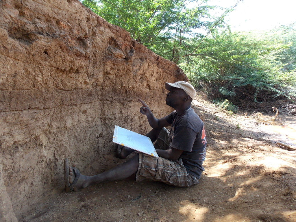 Victor studies the stratigraphy as we finished the excavation
